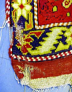 Beschädigter Teppich